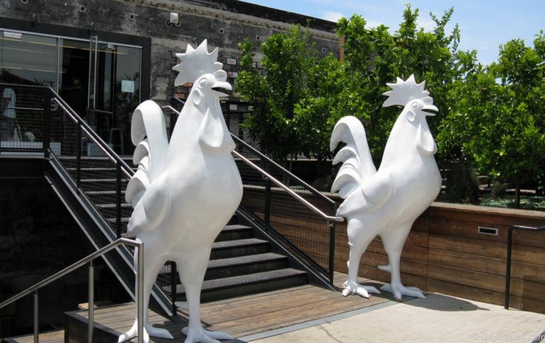 Back Entrance With Huge Roosters